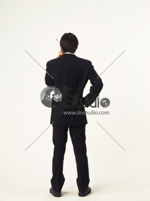 Back view of young business man on phone