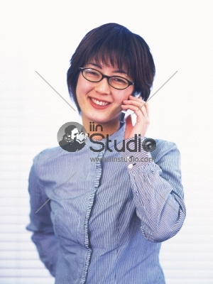 Asian Businesswoman walking on street passing by an office building