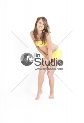 Young sexy woman posing over white, space for copy