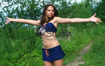 Attractive young woman with raised hands in field - Girl outdoors