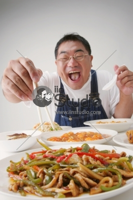 Mid Adult Man Eating a Chinese Food