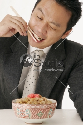 Business Man Eating a Japanese Food