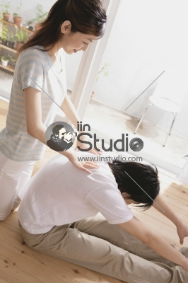 Young couple getting traditional thai stretching massage