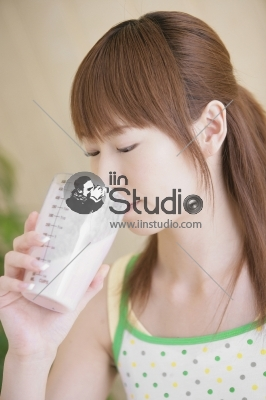 Young Woman Having Protein Drink