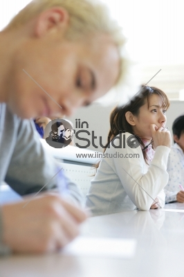 University students studying in a class, close up