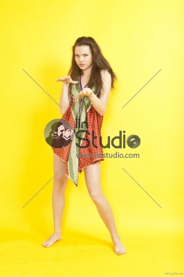 Portrait of beautiful young sexy woman on yellow background
