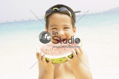 Young boy eating watermelon, portrait