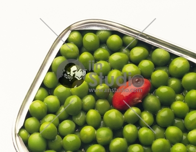 Heap of fresh wet green peas in white dish on white background