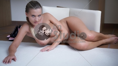 Healthy naked woman with long glossy hair lying over white