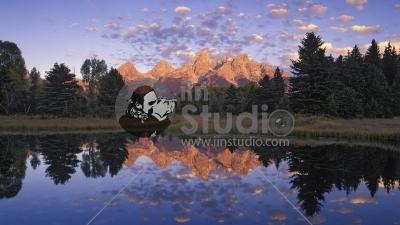 Teton Range mirrored on beaver pond at sunrise along Snake River