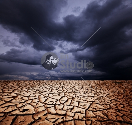 drought land in rainy sky above