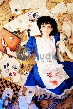 Portrait of a young woman dressed as Alice in Wonderland, video game