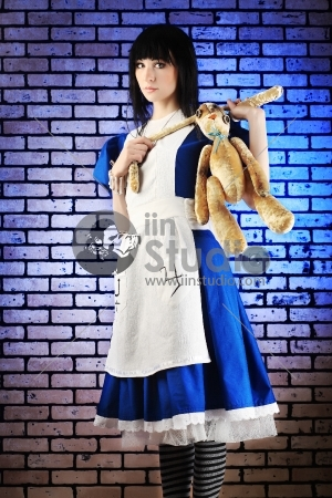 Portrait of a young woman dressed as Alice in Wonderland