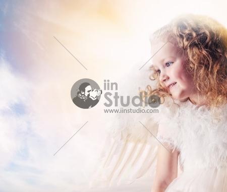 Little angel girl against sunny sky
