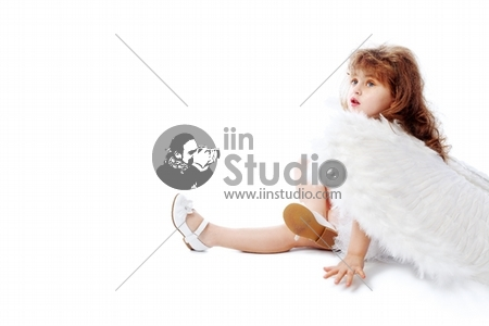 Beautiful little angel isolated over white background.
