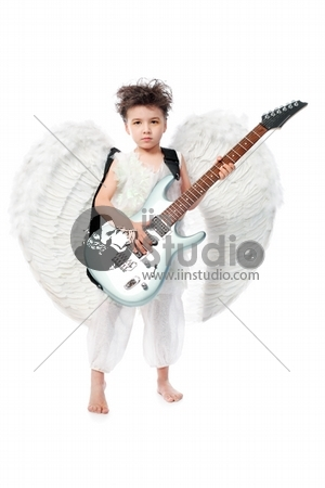 Beautiful little angel with a guitar at a white background.