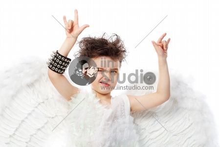 Beautiful little angel in rock style at a white background.