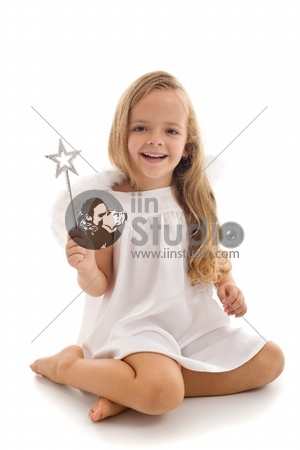 Little happy fairy or angel with magic wand sitting - isolated