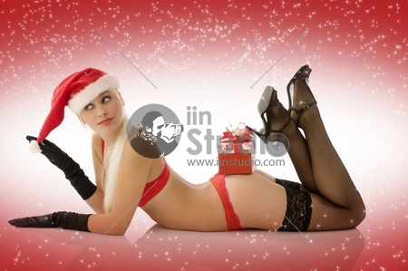 sexy young girl laying down with red lingerie gloves and christmas hat