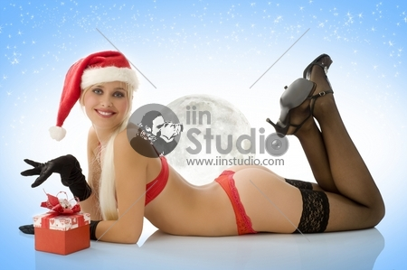 sexy young girl laying down in lingerie gloves stocking and christmas hat