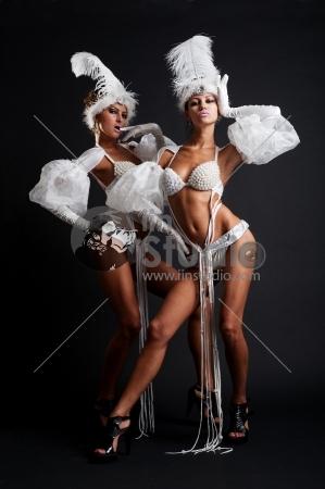 Beautiful Club Girls Posing Against Dark Background