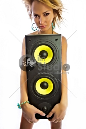 Blond attractive girl is covered with the huge musical subwoofer