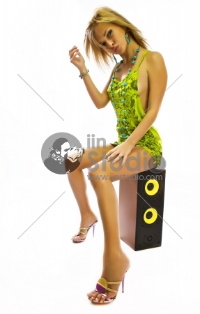 Pretty young lady listening to music isolated on white background