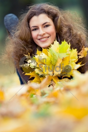 outdoor portrait of smiling young woman, with copyspace