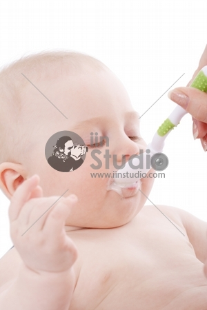 Feeding, Beautiful baby, Shot in studio, Isolated on white.