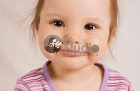 small joyful smiling girl in rose shirt