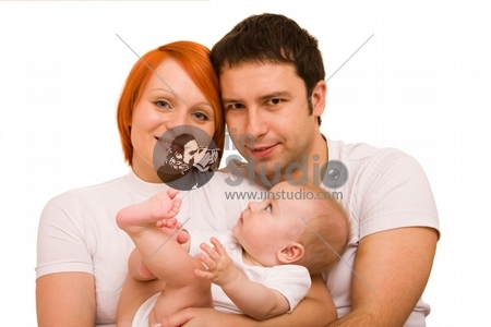 Happy family - father, mother and their cute little baby