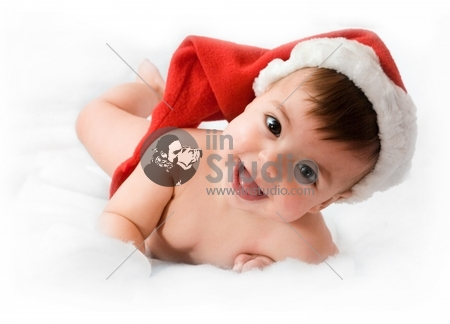 adorable baby smiling with christmas hat on white background