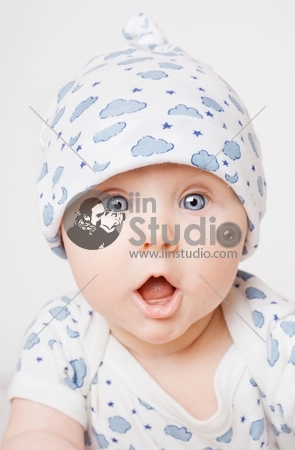 Small cute surprised child in blue pajama