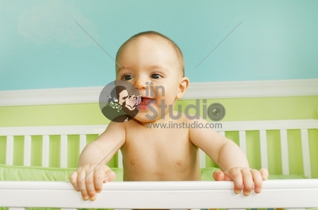 Baby Boy Smiling in crib