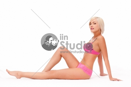 Beautiful blond woman wearing pink linergie over white
