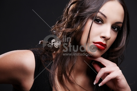 Attractive young woman wearing red lipstick.