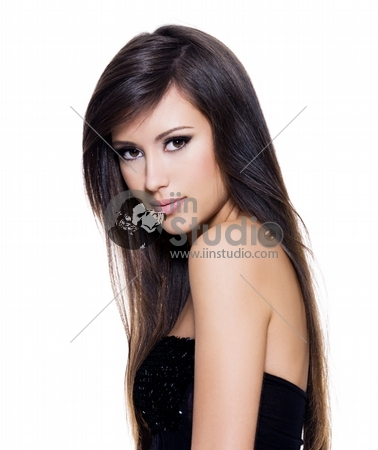 Sensuality beautiful woman with long hair posing isolated on white background