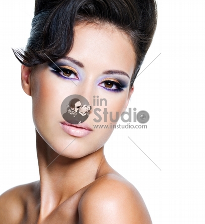 Beautiful face of a glamour woman with modern brightly makeup