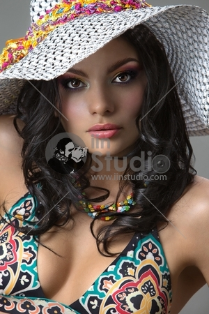Beautiful fashion girl with retro cap