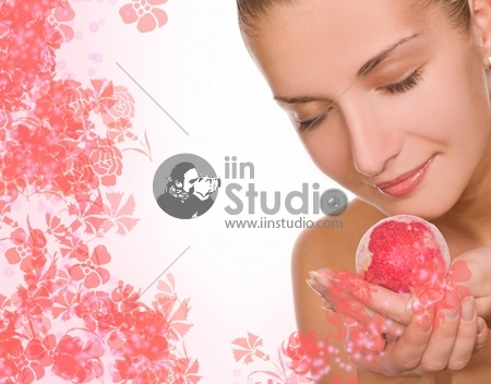 Beautiful girl with an aroma bath ball