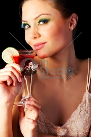 A Beautiful Young Woman Enjoying A Cocktail