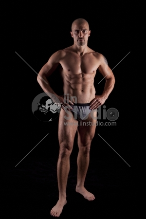 Sexy male's body on black