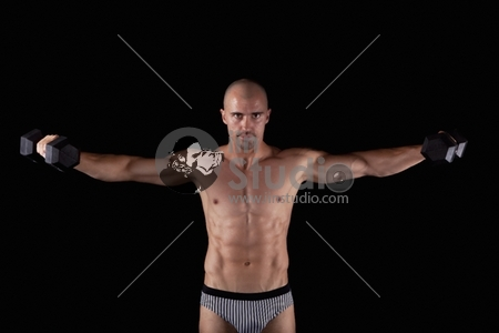 Sexy young muscle man with dumbells
