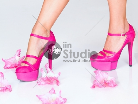 Fashion pink high heels and flowers isolated