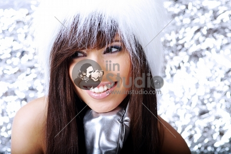 Winter Girl with beautiful make up, silver gloves