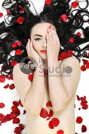 beautiful young nude woman with roses