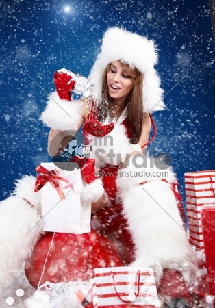 winter woman with a christmas gift
