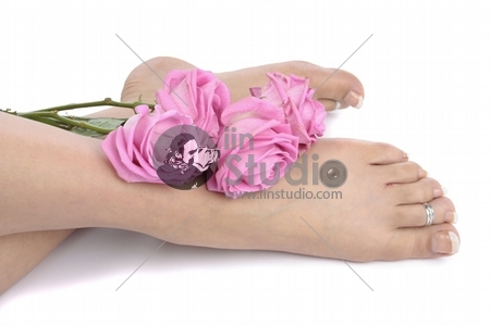 Woman legs and flowers over white background