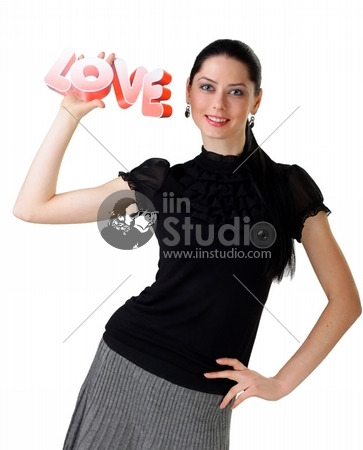 The beautiful woman in hands shows a word love