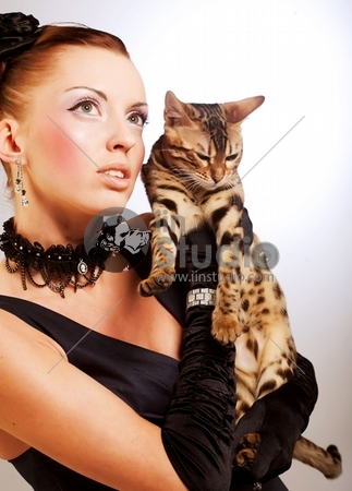 elegant young woman with cat